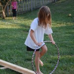 Hula hoop balance beam challenge.